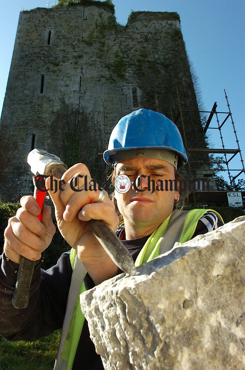 Stonemason Vincent McCann prepares a corner stone to be replaced during conservation work on the Watch Tower in Clonlara.Pic Arthur Ellis.