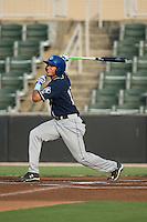 Omar Carrizales (19) of the Asheville Tourists follows through on his swing against the Kannapolis Intimidators at Intimidators Stadium on June 25, 2015 in Kannapolis, North Carolina.  The Intimidators defeated the Tourists 9-8.  (Brian Westerholt/Four Seam Images)