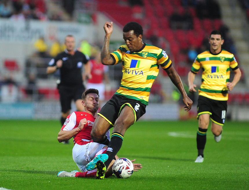 Rotherham United's Lee Frecklington tackles Norwich City's Andre Wisdom<br /> <br /> Photographer Andrew Vaughan/CameraSport<br /> <br /> Football - Capital One Cup Second Round - Rotherham United v Norwich - Tuesday 25th August 2015 - New York Stadium - Rotherham<br />  <br /> &copy; CameraSport - 43 Linden Ave. Countesthorpe. Leicester. England. LE8 5PG - Tel: +44 (0) 116 277 4147 - admin@camerasport.com - www.camerasport.com
