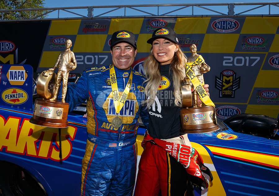 Apr 23, 2017; Baytown, TX, USA; NHRA top fuel driver Leah Pritchett (right) celebrates with funny car teammate Ron Capps after winning the Springnationals at Royal Purple Raceway. Mandatory Credit: Mark J. Rebilas-USA TODAY Sports