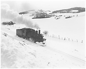 Engineer's-side view of RGS K-27 #455 traveling light in fresh snow on south side of Dallas Divide near Noel.<br /> RGS  Noel, CO
