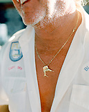 USA, Florida, fishing captain wearing marlin pendant, close-up, Islamorada