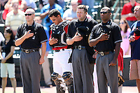Rochester Red Wings catcher Jose Morales with umpires Chris Bakke, Travis Brown, and Alan Porter during a game vs. the Louisville Bats Sunday, May 16, 2010 at Frontier Field in Rochester, New York.   Rochester defeated Louisville by the score of 4-3.  Photo By Mike Janes/Four Seam Images
