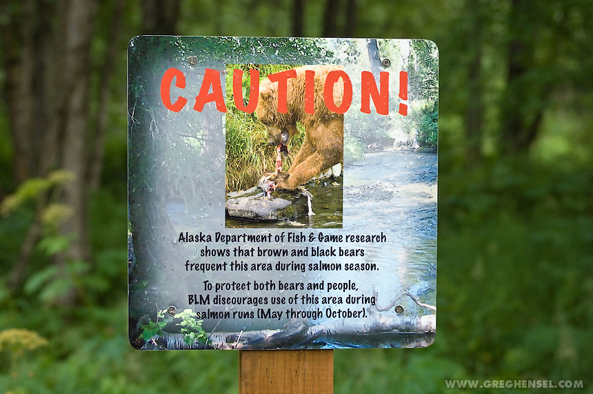 A sign warns visitors of bears on a hiking trail in Anchorage . Summer in Southcentral Alaska.
