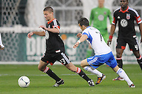 D.C. United midfielder Perry Kitchen (23) shields the ball against Montreal Impact midfielder Felipe Martins (7)  D.C. United tied The Montreal Impact 1-1, at RFK Stadium, Wednesday April 18 , 2012.