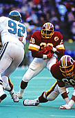 Washington Redskins running back George Rogers (38) carries the ball during the game against the Philadelphia Eagles at Veterans Stadium in Philadelphia, Pennsylvania on December 21, 1986.  Defending for the Eagles is Reggie White (92) and blocking for the Redskins is Russ Grimm (68).  The Redskins won the game 21 - 14.<br /> Credit: Arnie Sachs / CNP