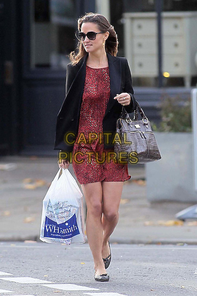 Pippa Middleton spotted in Notting Hill, London, England..October 6th, 2011.full length sunglasses shades red dress blazer black print brown bag purse wh smith plastic carrier bag shopping.CAP/HIL.©John Hillcoat/Capital Pictures.