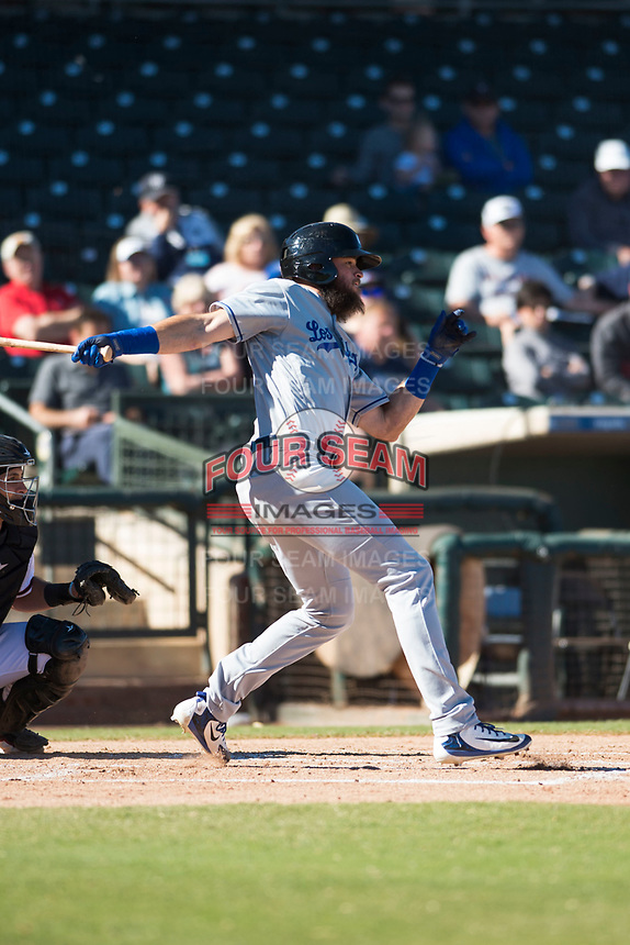 Glendale Desert Dogs right fielder Cody Thomas (40), of the Los Angeles Dodgers organization, lines a single to center field during an Arizona Fall League game against the Surprise Saguaros at Surprise Stadium on November 13, 2018 in Surprise, Arizona. Surprise defeated Glendale 9-2. (Zachary Lucy/Four Seam Images)