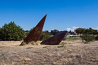 The Duplex Cone Sculpture follows the sun.  On the Autumnal Equinox, September 22, 2017, the two cones were in shadow in their concave interiors and in full sunlight on their convex  sides.  The cones are seen here with the interpretive sign at the Martin Luther King Jr. Regional Shoreline in Oakland, California.
