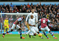 Andre Ayew of Swansea City takes on Idrissa Gueye of Aston Villa during the Barclays Premier League match between Aston Villa v Swansea City played at the Villa Park Stadium, Birmingham on October 24th 2015