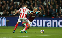 West Ham United's Marko Arnautovic and Stoke City's Ryan Shawcross<br /> <br /> Photographer Rob Newell/CameraSport<br /> <br /> The Premier League - West Ham United v Stoke City - Monday 16th April 2018 - London Stadium - London<br /> <br /> World Copyright &copy; 2018 CameraSport. All rights reserved. 43 Linden Ave. Countesthorpe. Leicester. England. LE8 5PG - Tel: +44 (0) 116 277 4147 - admin@camerasport.com - www.camerasport.com