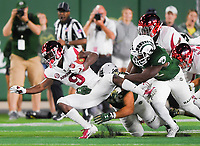 NWA Democrat-Gazette/CHARLIE KAIJO Colorado State Rams defenders tackle Arkansas Razorbacks wide receiver De'Vion Warren (9) during the third quarter of a football game, Saturday, September 8, 2018 at Colorado State University in Fort Collins, Colo.