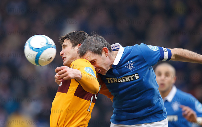David Weir smashes his head into John Sutton's shoulder after using his guile to stop the Motherwell forward jumping for the ball