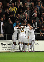 Pictured: Mark Gower of Swansea celebrating his opening goal, mobbed by teammates. Tuesday 12 April 2011<br />