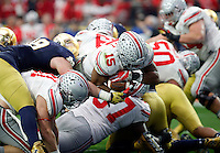 Ohio State Buckeyes running back Ezekiel Elliott (15) scores a rushing touchdown against Notre Dame Fighting Irish in the second quarter during the Fiesta Bowl in the University of Phoenix Stadium on January 1, 2016.  (Dispatch photo by Kyle Robertson)