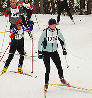 Madison's Lisa Johns leads a pack of nordic skiers during the 43K race Saturday, 2/2/08, during the 20th annual Badger State Winter Games. This cross country ski event is held in Nine Mile Forest near Wausau. Other skiers pictured (front to back) are Janice Hansen (Middleton), Adam Book (Madison), and Mindy Borchardt (Stevens Point).