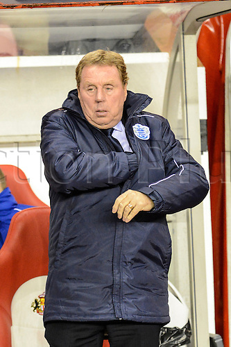 27.11.2012 Sunderland, England. Harry Redknapp looking for his tema notes prior to the Premier League game between Sunderland and Queens Park Rangers at the Stadium of Light.