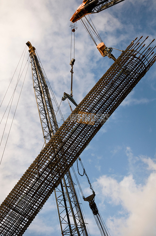 Large cranes erecting rebar column.