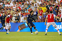Landover, MD - July 23, 2019: Real Madrid Marcelo (12) dribbles pass several Arsenal defenders during the match between Arsenal and Real Madrid at FedEx Field in Landover, MD.   (Photo by Elliott Brown/Media Images International)