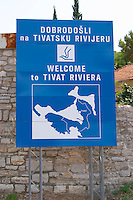 Blue sign welcoming visitors to the Tivat Riviera in English and Montenegrin. Montenegro, Balkan, Europe.