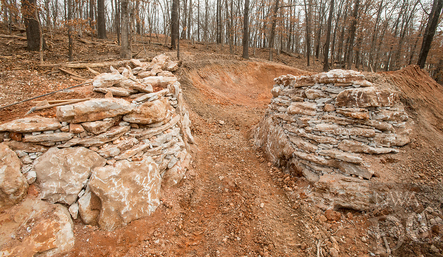 NWA Democrat-Gazette/BEN GOFF @NWABENGOFF<br /> A rock feature, which will be spanned by a wooden bridge, begins to come together on a new downhill mountain bike trail Thursday, Jan. 10, 2019, at the Slaughter Pen trail system in Bentonville. The new line will be a hard-packed flow line builder Jeremy Witek described as a 'dirt roller coaster' with sweeping banked turns and table top jumps. The crew is also re-working the existing downhill line into a more natural-surface and technical compliment to the new line.