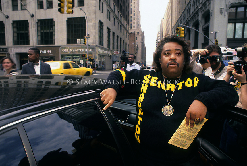 (920501-SWR02) NEW YORK, NY -- 2MAY92 --The Reverend Al Sharpton stands by his car wearing his trademark medalion and Senator Sharpton sweaterm and holding a voting ballot during his run for US Senate..In the May 20th2001 issue, Time magazine reported Rev. Sharpton plans to seek the Democratic Presidential Nomination in 2004 © Stacy Walsh Rosenstock