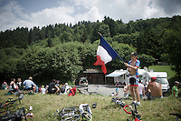 young flagged fan<br /> <br /> Stage 18 (ITT) - Sallanches &rsaquo; Meg&egrave;ve (17km)<br /> 103rd Tour de France 2016