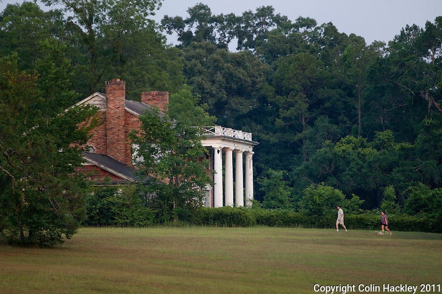 GOVERNOR'S PARK: A couple walks their dog at the close of the day..COLIN HACKLEY PHOTO