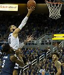 Nevada forward Cody Martin (11) takes a jump shot against Akron in the first half of an NCAA college basketball game in Reno, Nev., Saturday, Dec. 22, 2018. (AP Photo/Tom R. Smedes)