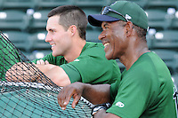 Infielder John Hinson (3) of the Lexington Legends, left, watches batting practice with manager Ivan De Jesus prior to a game against the Greenville Drive on May 2, 2012, at Fluor Field at the West End in Greenville, South Carolina. Lexington won, 4-2. (Tom Priddy/Four Seam Images)