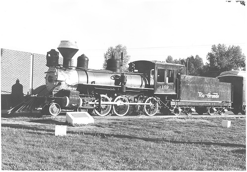 3/4 fireman's-side view of D&amp;RGW #169 on display in Alamosa.<br /> D&amp;RGW  Alamosa, CO  Taken by Schnepf, Ted - 6/1971
