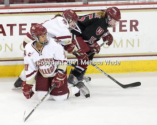 Blake Bolden (BC - 10), Kristina Brown (BC - 2), Katharine Chute (Harvard - 15) - The Boston College Eagles defeated the Harvard University Crimson 3-1 to win the 2011 Beanpot championship on Tuesday, February 15, 2011, at Conte Forum in Chestnut Hill, Massachusetts.