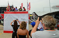 Jun. 29, 2012; Joliet, IL, USA: NHRA fans take pictures of the Toyota top fuel dragster drivers during qualifying for the Route 66 Nationals at Route 66 Raceway. Mandatory Credit: Mark J. Rebilas-