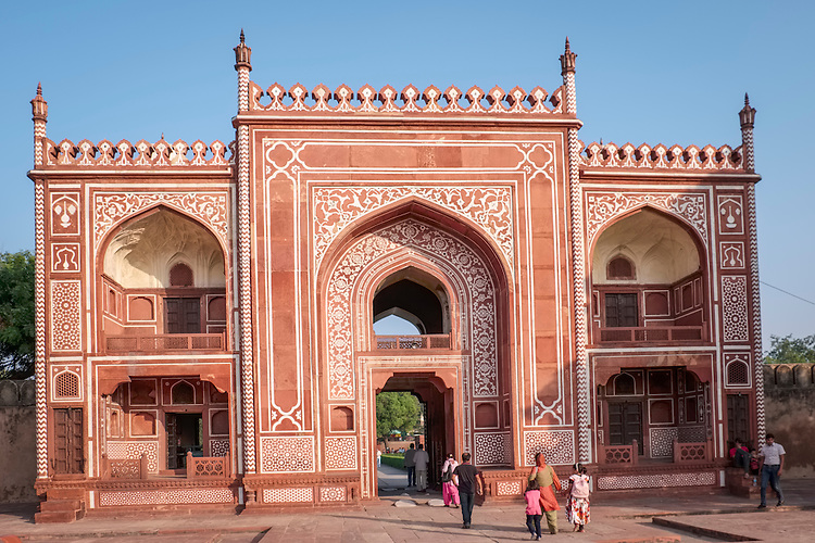 "An ornate gateway allows passage to Itmad ud Daulah Tomb, ""Baby Taj"",which is across the Yamuna River from the Taj Mahal."