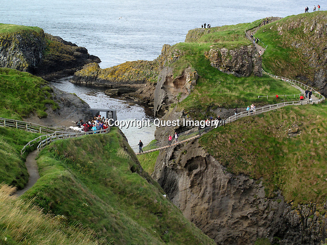 Carrick-a-Rede Rope Bridge is a famous rope bridge near Ballintoy in County Antrim, Northern Ireland. The bridge links the mainland to the tiny island of Carrickarede. It spans 20 metres and is 30 metres above the rocks below. <br /> Photo by Mike Rynearson/Quest Imagery