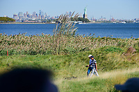 Rickie Fowler (USA) and Charl Schwartzel (RSA) make their way down 10 during round 1 foursomes of the 2017 President's Cup, Liberty National Golf Club, Jersey City, New Jersey, USA. 9/28/2017.<br /> Picture: Golffile | Ken Murray<br /> ll photo usage must carry mandatory copyright credit (&copy; Golffile | Ken Murray)