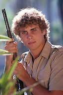 Vassouras, district of Rio de Janeiro, Brazil. 1981.  A family in Africa is besieged by a group of lions, driven mad by the drought. They have to survive multiple attacks but some of their colleagues are eaten by the lions. From the film Savage Harvest, directed by Robert E. Collins.Photo of the actor Derek Partridge.