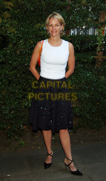 ELIZABETH MURDOCH.Mercedes-Benz launch of new Maybach car and Tatler magazine summer party in Portman Square..www.capitalpictures.com.sales@capitalpictures.com.©Capital Pictures.cross-over heels, full skirt, black and white