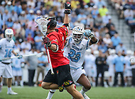 Baltimore, MD - April 28, 2018: Maryland Terrapins Bubba Fairman (2) fights off Johns Hopkins Blue Jays Daniel Jones (23) during game between John Hopkins and Maryland at  Homewood Field in Baltimore, MD.  (Photo by Elliott Brown/Media Images International)