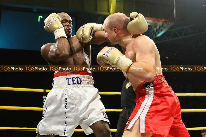 Gavin Rees (red shorts) defeats Ted Bami in the Quarter-Final of Prizefighter 'The Light-Welterweights' at Olympia National Hall, London, promoted by Barry Hearn / Matchroom Sport - 04/12/09 - MANDATORY CREDIT: Gavin Ellis/TGSPHOTO - Self billing applies where appropriate - Tel: 0845 094 6026