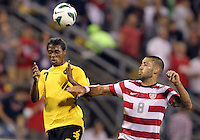 COLUMBUS, OHIO - SEPTEMBER 11, 2012:  Clint Dempsey (8) of the USA MNT goes up for a header against Jason Morrison (7) of  Jamaica during a CONCACAF 2014 World Cup qualifying  match at Crew Stadium, in Columbus, Ohio on September 11. USA won 1-0.