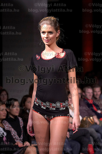 Model presents collections by Pussy Deluxe and Vive Maria during the opening underwear fashion show of the new event hall called Show-Room in Budapest, Hungary on October 26, 2007. ATTILA VOLGYI