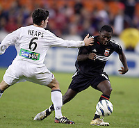 D.C. United's Freddy Adu looks to get around Jay Heaps of the Revolution. DC United defeated the New England Revolution 4 to 3 in a shoot out after overtime ended in a 3 all tie during the MLS Eastern Conference Championship at RFK Stadium, Washington, D.C., on Saturday, November 6, 2004..