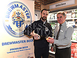 Paddy Matthews from Brewmaster with manger Ken Murtagh at the opening Dunne's Centra Ardee. Photo:Colin Bell/pressphotos.ie