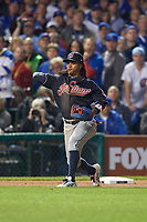 Cleveland Indians Michael Martinez (1) throws to first base in the ninth inning during Game 3 of the Major League Baseball World Series against the Chicago Cubs on October 28, 2016 at Wrigley Field in Chicago, Illinois.  (Mike Janes/Four Seam Images)