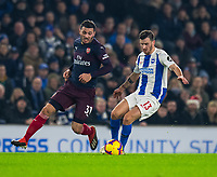 Brighton & Hove Albion's Pascal Gross (right)  under pressure from Arsenal's Sead Kolasinac (left) <br /> <br /> Photographer David Horton/CameraSport<br /> <br /> The Premier League - Brighton and Hove Albion v Arsenal - Wednesday 26th December 2018 - The Amex Stadium - Brighton<br /> <br /> World Copyright © 2018 CameraSport. All rights reserved. 43 Linden Ave. Countesthorpe. Leicester. England. LE8 5PG - Tel: +44 (0) 116 277 4147 - admin@camerasport.com - www.camerasport.com