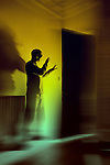 Man with Light behind door