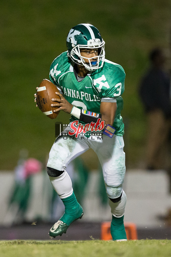 Damon Johnson (3) of the A.L. Brown Wonders rolls out to his right during first half action against the Hough Huskies at A.L. Brown High School on October 16, 2015 in Kannapolis, North Carolina.  The Huskies defeated the Wonders 21-7.  (Brian Westerholt/Sports On Film)