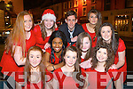 Singing group Plain Trouble who part Santa's visit to Kenmare on Saturday evening front row l-r: Rachel O'Connor, Aoife Cronin, Laura O'Keeffe. Back row: Sorcha O'Connor, Bronagh Murphy, Jade de Villiers III, Eoin Foran, Sinead Carroll, Niamh Whelton, and Caoimhe Lynch