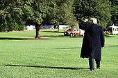 U.S. President Donald Trump raises his fist as he walks on the South Lawn before boarding Marine One at the White House, on October 13, 2018 in Washington, DC. President Trump is traveling to Kentucky.<br /> Credit: Olivier Douliery / Pool via CNP